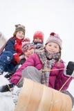 雪橇的孩子 图库摄影