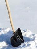 雪清洁的铁锹 免版税库存图片