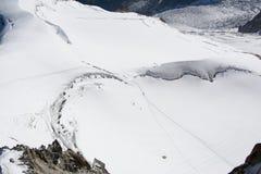 雪爬山者 免版税库存照片
