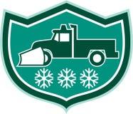 雪犁卡车减速火箭雪花的盾 图库摄影