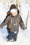 雪的愉快的男孩 免版税图库摄影
