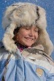 雪的逗人喜爱的女孩 免版税库存照片