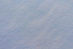 雪纹理在蓝色光的 图库摄影