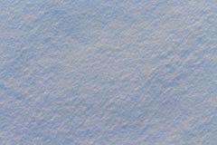 雪纹理在蓝色光的 免版税库存图片