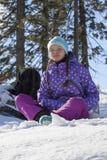 滑雪胜地的俏丽的女孩 免版税图库摄影