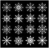 雪花剪影象,标志,设计集合 冬天,圣诞节在黑背景的传染媒介例证 免版税库存图片