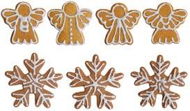 以雪花和天使的形式姜饼曲奇饼 免版税库存照片