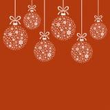 雪花圣诞节装饰白色球在红色背景的 免版税库存图片