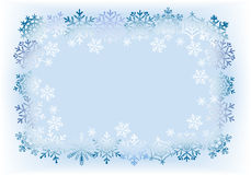 从雪花的框架在浅兰的背景。 图库摄影