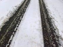 雪路踪影 免版税库存图片