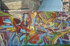 零件图街道画-有抽象的五颜六色的墙壁 免版税库存照片