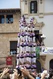 雷乌斯,西班牙- 2014年10月25日:Castells表现,卡斯特尔是在节日传统上建造的一个人的塔在卡塔龙尼亚 库存照片