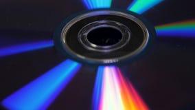 雷射唱片或dvds背景  光强光在盘DVD,从光的美好的色的强光上的, 免版税库存照片