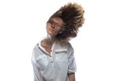 震动顶头金发碧眼的女人 库存图片