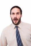 震惊商人画象与开放的嘴的 免版税库存图片