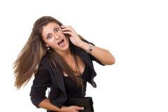 震惊女商人谈话在电话 库存照片