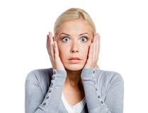 震惊妇女在头上把手放 免版税库存照片