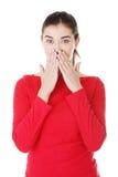 震惊妇女覆盖物她的嘴用现有量 库存图片