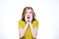 震惊青少年的女孩画象被隔绝的白色背景 图库摄影