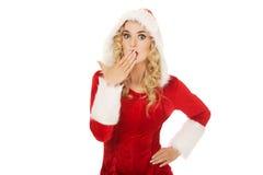 震惊年轻美丽的圣诞老人妇女 免版税库存照片