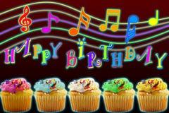 霓虹灯与色的杯子蛋糕的生日快乐概念 库存照片