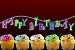 霓虹灯与色的杯子蛋糕的生日快乐概念 免版税库存照片