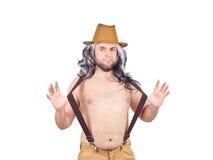 露胸部的帽子的滑稽的人 库存图片