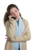 青少年乏味的移动电话 图库摄影