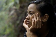 青少年亚裔沮丧的女孩 免版税库存图片