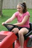 青少年刈草机的骑马 免版税库存图片