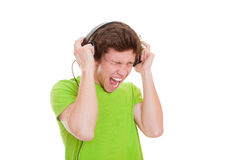 青少年唱歌与耳机 免版税图库摄影
