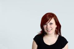 青少年女孩俏丽的红头发人 图库摄影