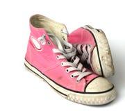 青少年女孩桃红色的运动鞋 库存照片