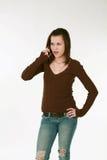 青少年女孩的电话 免版税图库摄影