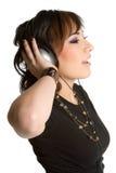 青少年女孩的耳机 免版税库存照片