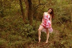 青少年森林的女孩 库存照片