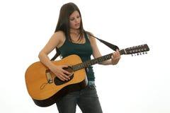 青少年的吉他弹奏者 图库摄影