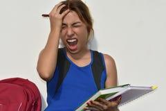 青少年的女学生和重音 免版税库存图片