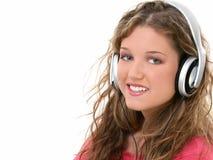青少年美丽的女孩的耳机 库存图片