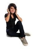 青少年耳机的讲西班牙语的美国人 库存图片