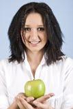 青少年苹果的女孩 免版税库存图片