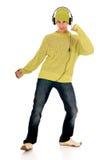 青少年跳舞的耳机 免版税库存照片