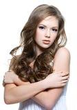 青少年长期美丽的卷曲女孩的头发 库存图片