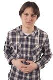 青少年与stomachache 免版税图库摄影