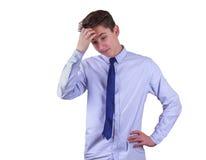 青少年男孩怀疑 查出在白色 免版税库存照片