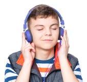 青少年男孩的耳机 图库摄影