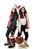 青少年的圣诞节姐妹 库存照片