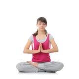 青少年的培训女子瑜伽 库存图片