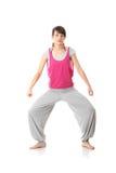 青少年的培训女子瑜伽 免版税库存图片