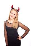 青少年的女孩佩带的恶魔垫铁 免版税库存照片